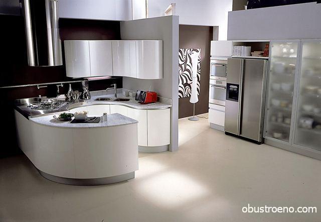 Кухня углового типа с обтекаемыми фасадами