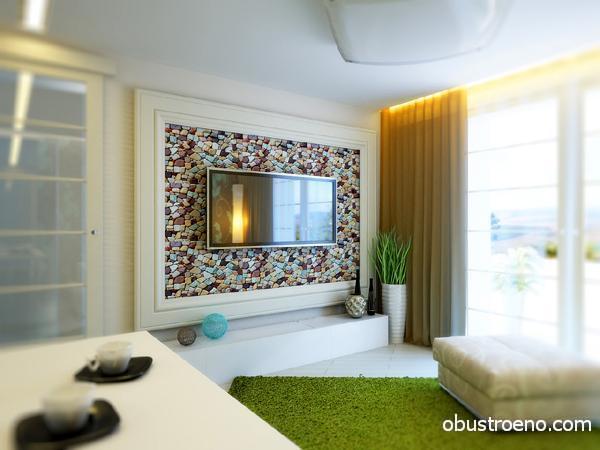 На фото – декорированная рамой и мозаикой стена