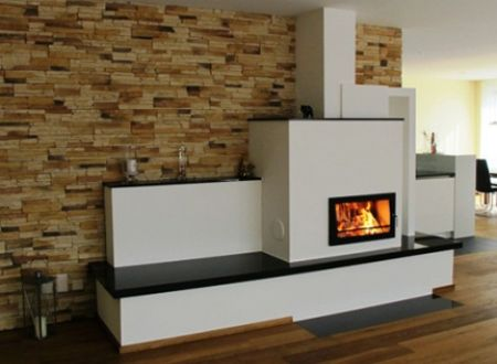 Русская печка в современном интерьере может смотреться очень стильно, особенно если в конструкции присутствует камин
