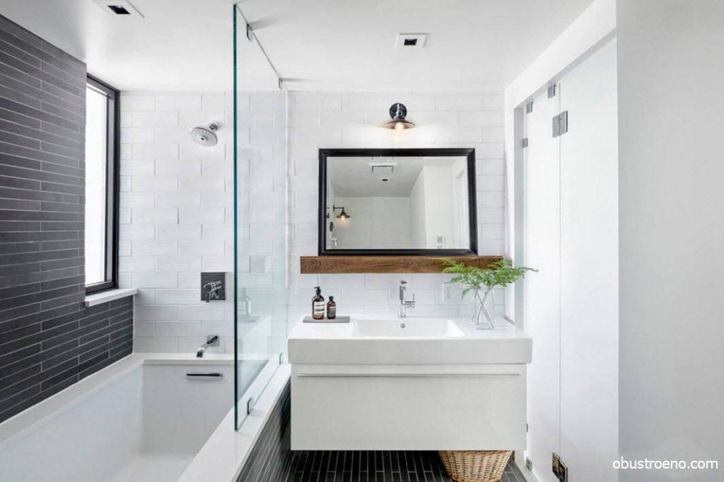Сочетание черного и белого, а также использование металла, стекла и дерева делает стиль санузла стильным и выверенным