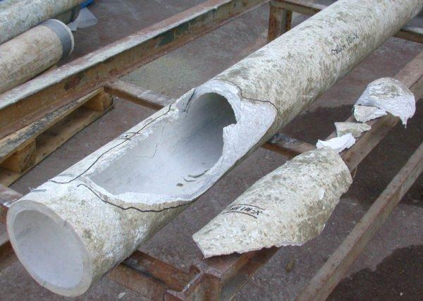 Разрушение асбоцемента в результате длительного воздействия высокой температуры.