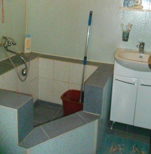 Гибрид ванны и душевого поддона