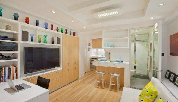 На этом фото -кухня и туалет в одной комнате, но они разделены перегородкой