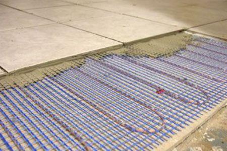 Кабельные маты под кафельной напольной плиткой.
