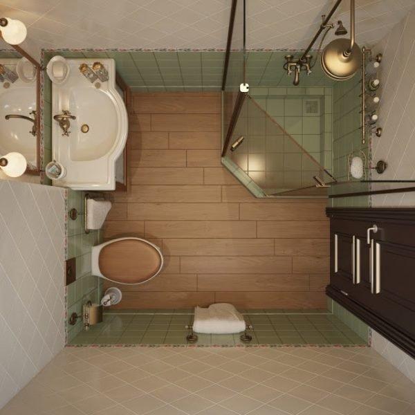 Незаметный душ в углу - отличный вариант для небольшой ванной
