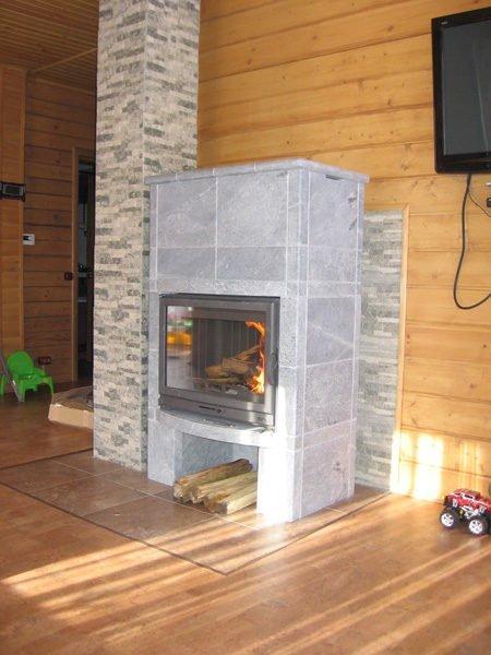 Дымоход и камин отделанный керамогранитом.