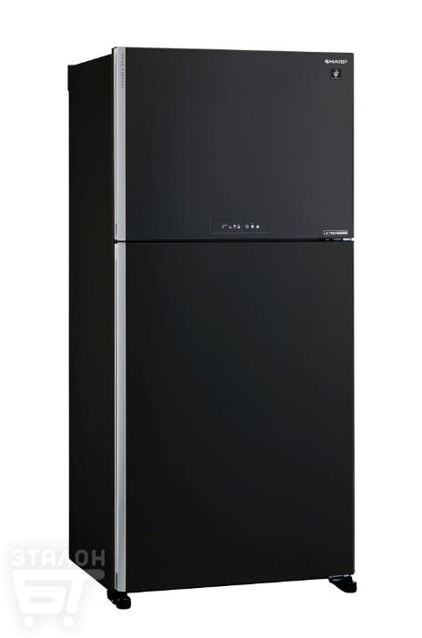 Такой холодильник добавит интерьеру солидности.