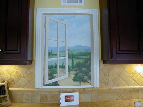 Картина с распахнутым окном это отличное решение для маленькой кухни.