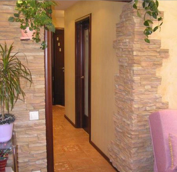 Decorating the arch with decorative stone: photo of doorways.
