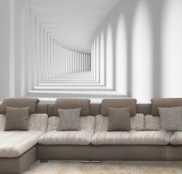 На фото — пример удачного визуального расширения гостиной при помощи трёхмерных обоев, изображающих уходящий вдаль коридор