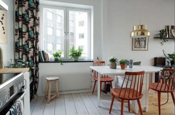Объединение кухни с гостиной позволит значительно расширить полезное пространство