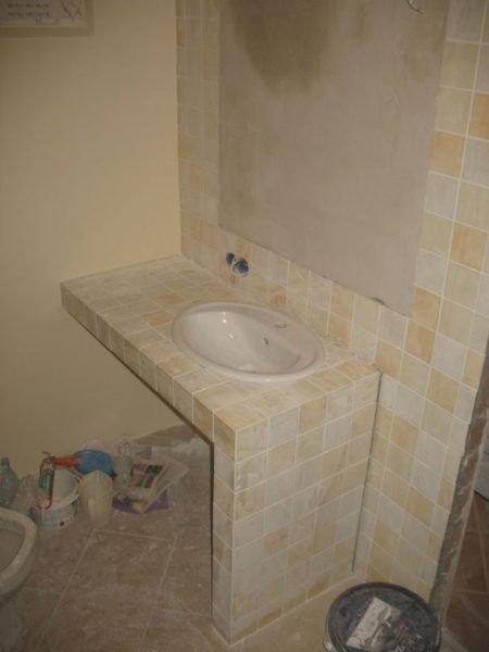 Отделка гипсокартонной тумбы в ванной комнате
