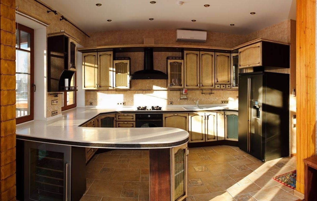 дизайн кухни-гостиной с барной стойкой в частном доме фото
