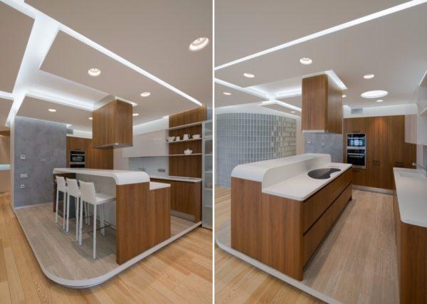 Власть на кухне отдана белому глянцу, натуральному дереву и «холодному» бетону